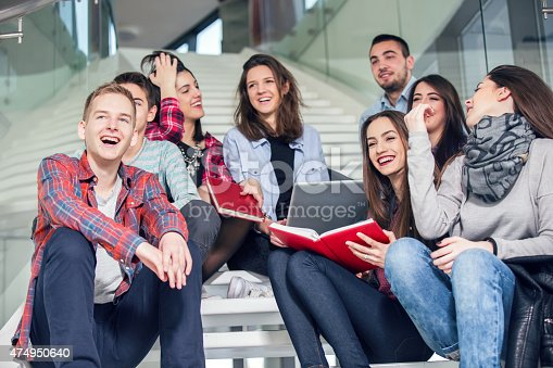 istock Medium group of students studying on steps of school building 474950640