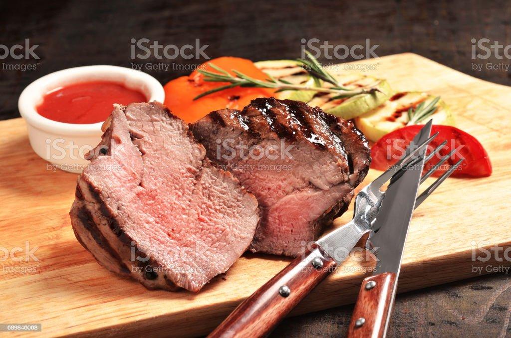 Medium Rare Filet mignon steak on wooden board, selected focus - foto de acervo