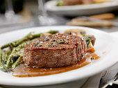 istock Medium Rare Fillet Mignon Steak with a Mushroom Sauce, Roasted Green Beans and Mushrooms 1200523712