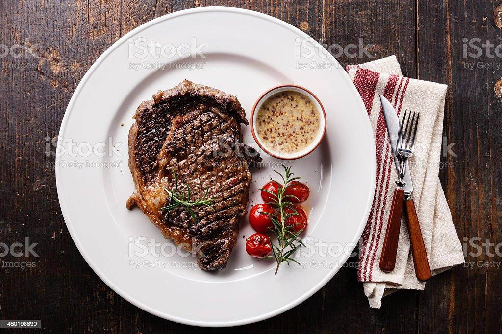 Medium rare grilled Beef steak Ribeye stock photo