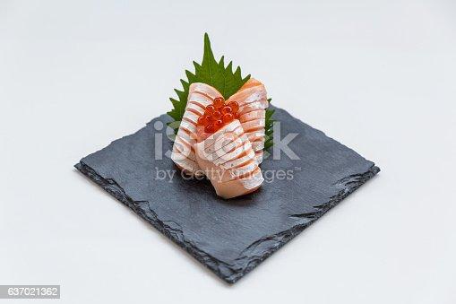 istock Medium Rare Salmon Sashimi in Stone Plate. 637021362