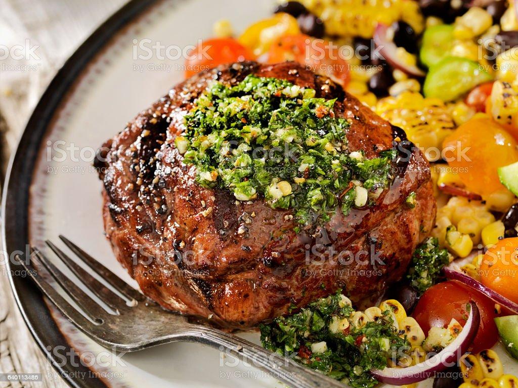 Medium Rare Sirloin Steak with Chimichurri Sauce stock photo