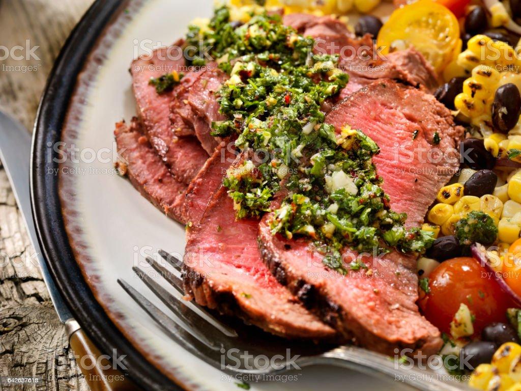 Medium Rare Sirloin Steak with Chimichurri Sauce and Corn Salad