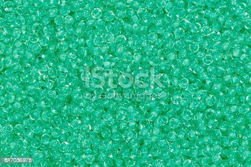 istock Medium spring green seed beads 817036978