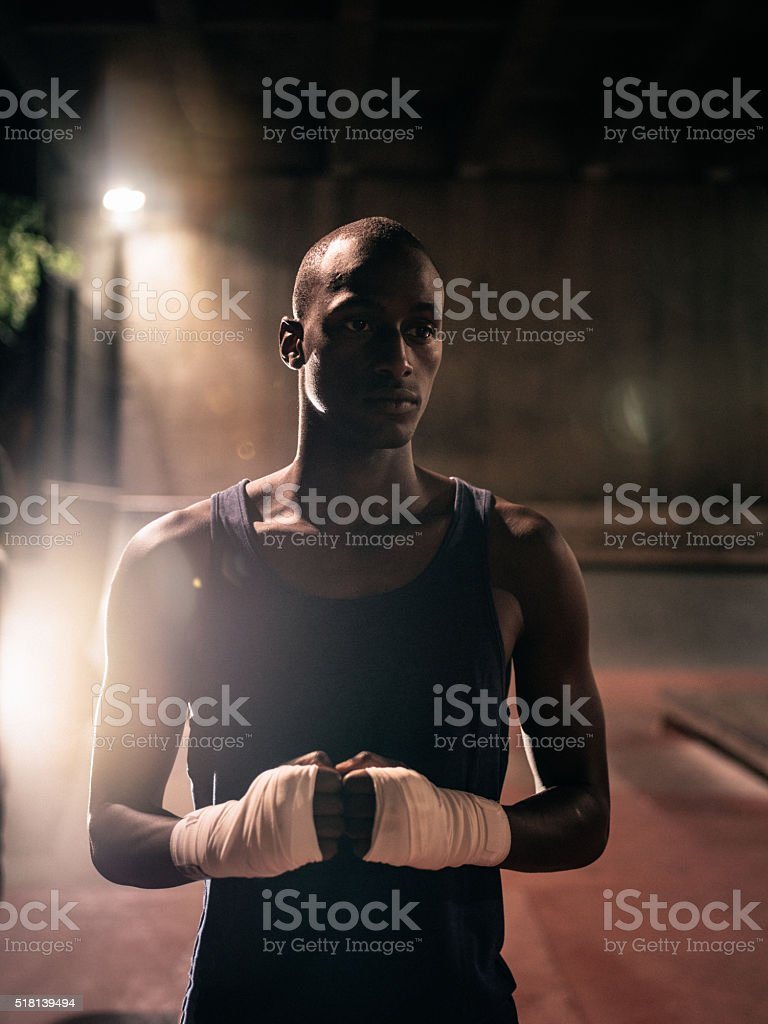 Medium top shot of determined and focused afro-american boxer stock photo