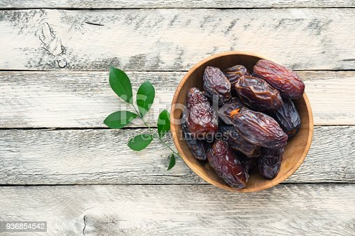 istock Medjool Dates on wooden table. 936854542