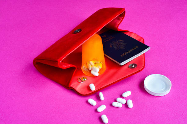 meds and passport in purse - prescription meds stock pictures, royalty-free photos & images