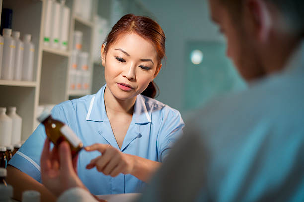meds chat nurse discussing medicines with doctor prescription meds stock pictures, royalty-free photos & images
