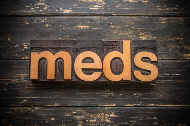 "Meds Concept Vintage Wooden Letterpress Type Word The word ""MEDS"" written in vintage wood letterpress type on a vintage rustic background. prescription meds stock pictures, royalty-free photos & images"