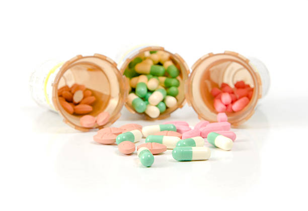 meds on white - prescription meds stock pictures, royalty-free photos & images