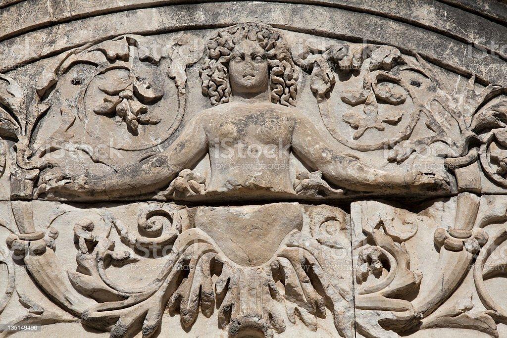 Medusa Detail of Hadrian's Temple royalty-free stock photo