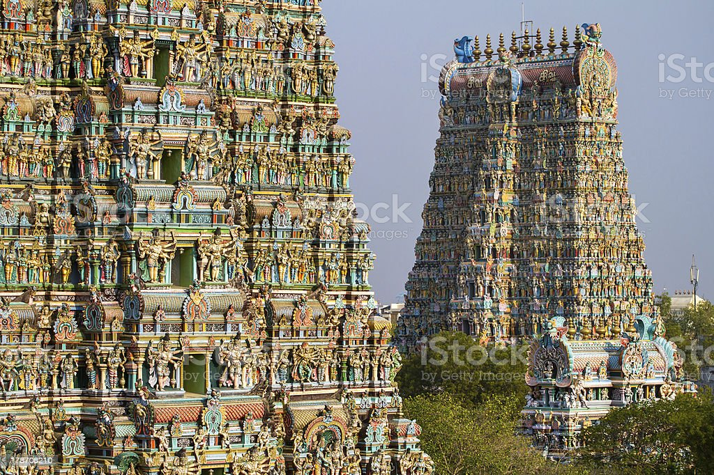 Meenakshi temple in Madurai MADURAI, INDIA - MARCH 3: Meenakshi temple - one of the biggest and oldest Indian temples on March 3, 2013 in Madurai, Tamil Nadu, India. The 14 gateway towers called gopura ranging from 45 to 50m. Ancient Stock Photo