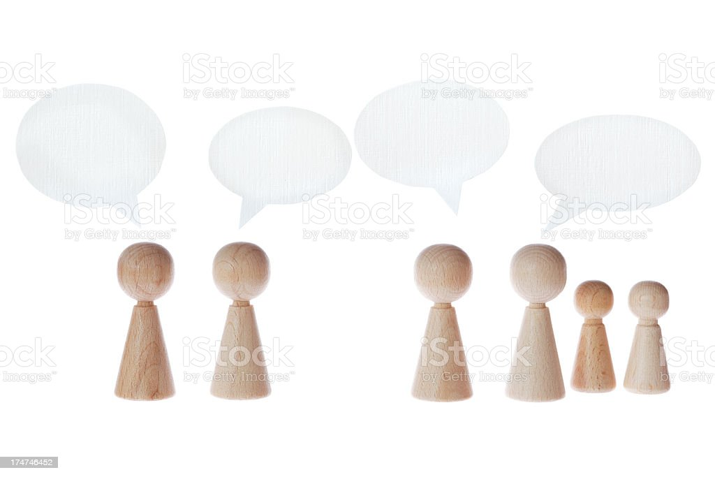 meeples with speech bubbles royalty-free stock photo