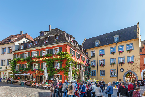 Meersburg, Germany - September 26, 2014: A group of people is ready for the visit of Meersburg, a medieval city with a lower town and a upper town, both pedestrian and connected by stairways and steep alleys. Its landmarks are two castles, the Old Castle (7th century), and the New Castle (18th century), which now hosts a museum.