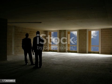 Two men meet in empty building