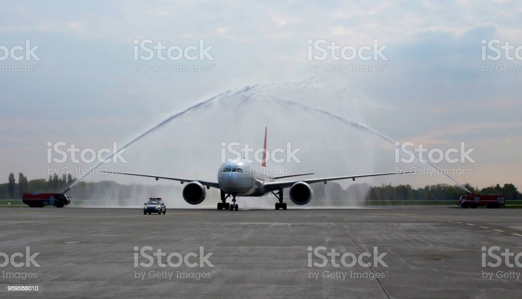 Meeting about arrival of the first flight with water salute stock photo