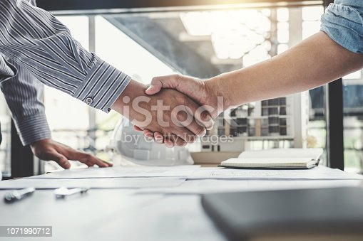 1071990712 istock photo Meeting and greeting, Two engineer or architect meeting for project, handshake after consultation and conference new project plan, contract for both companies, success, partnership 1071990712