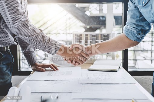 1071990712 istock photo Meeting and greeting, Two engineer or architect meeting for project, handshake after consultation and conference new project plan, contract for both companies, success, partnership 1079714662