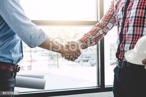 1071990712 istock photo Meeting and greeting, Two engineer or architect meeting for project, handshake after consultation and conference new project plan, contract for both companies, success, partnership 941073366