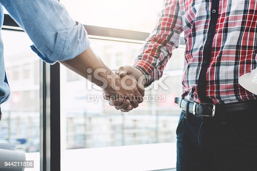 1071990712 istock photo Meeting and greeting, Two engineer or architect meeting for project, handshake after consultation and conference new project plan, contract for both companies, success, partnership 944211516
