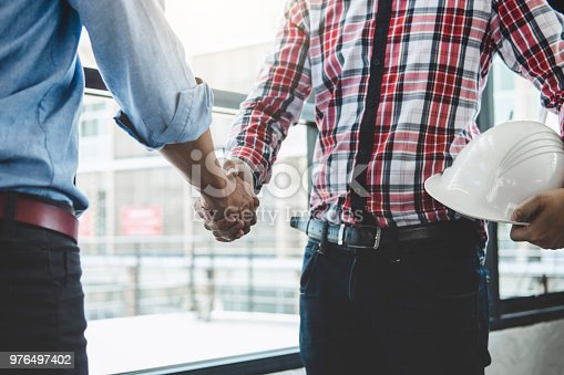 1071990712 istock photo Meeting and greeting, Two engineer or architect meeting for project, handshake after consultation and conference new project plan, contract for both companies, success, partnership 976497402