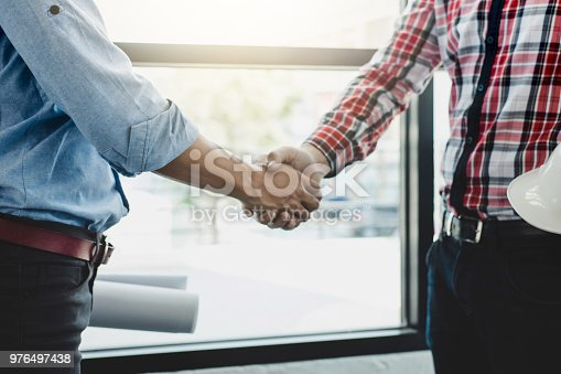 1071990712 istock photo Meeting and greeting, Two engineer or architect meeting for project, handshake after consultation and conference new project plan, contract for both companies, success, partnership 976497438