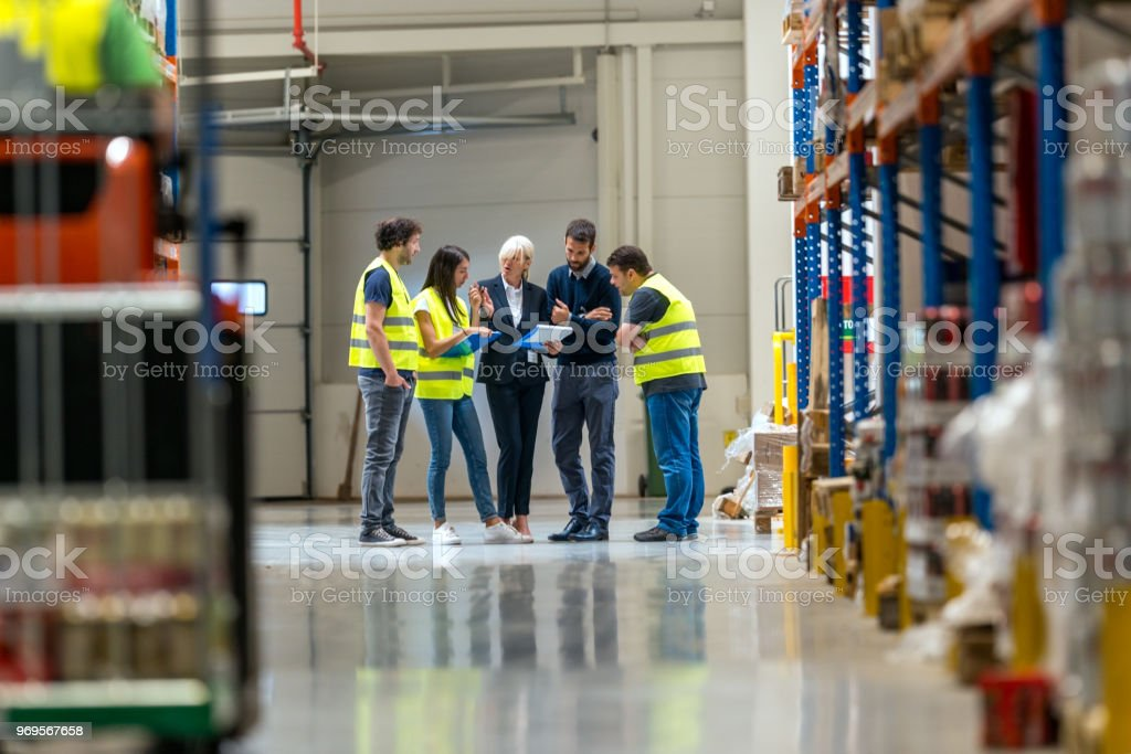 Meeting at warehouse stock photo