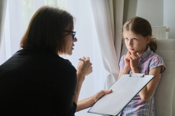 meeting child girl with school counselor psychotherapist. - school counselor stock pictures, royalty-free photos & images