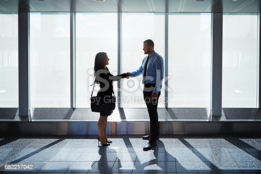 istock Meeting contacts at arrivals 682217042