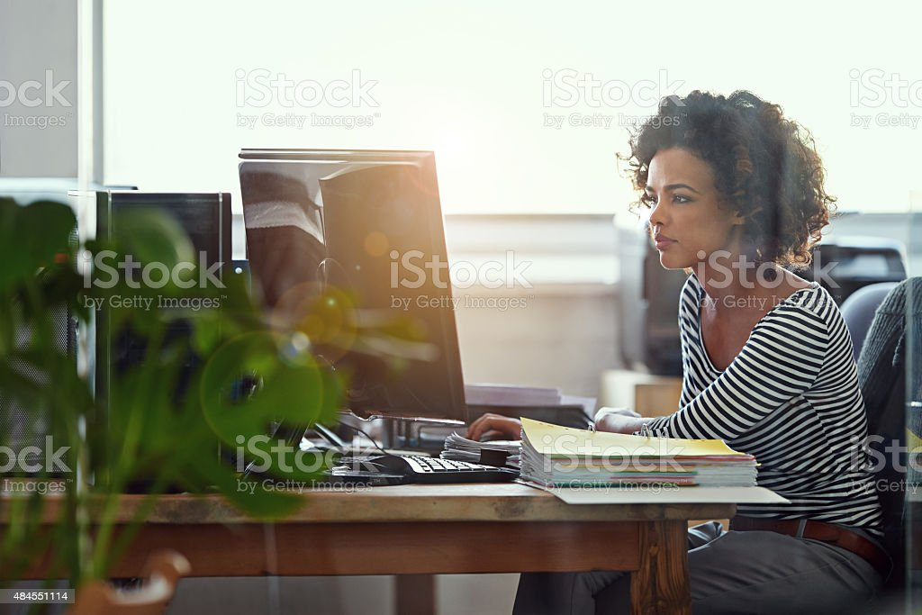 Meeting deadlines is what she does stock photo