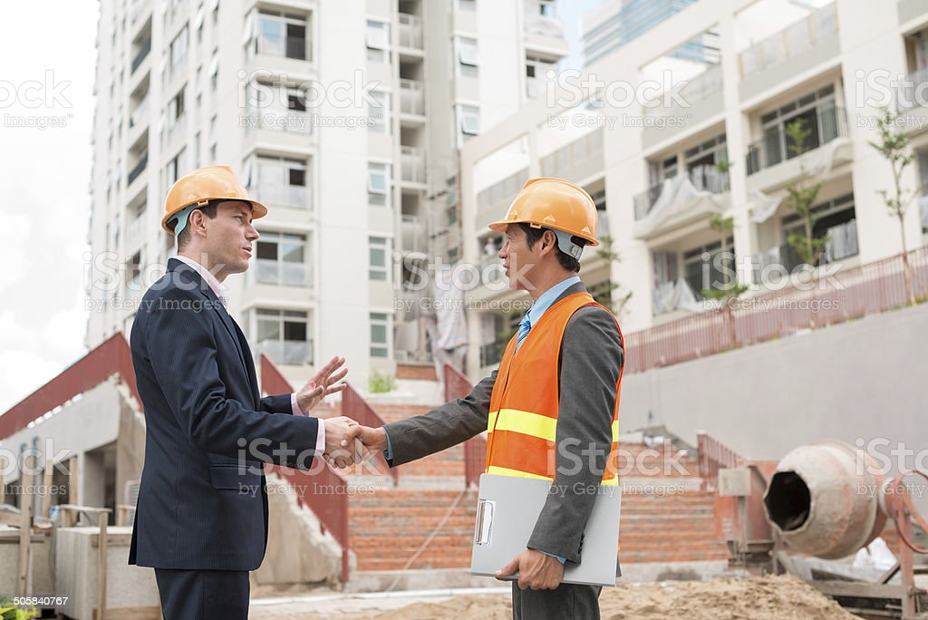 Meeting engineer Businessman meeting Asian engineer at the construction site Adult Stock Photo