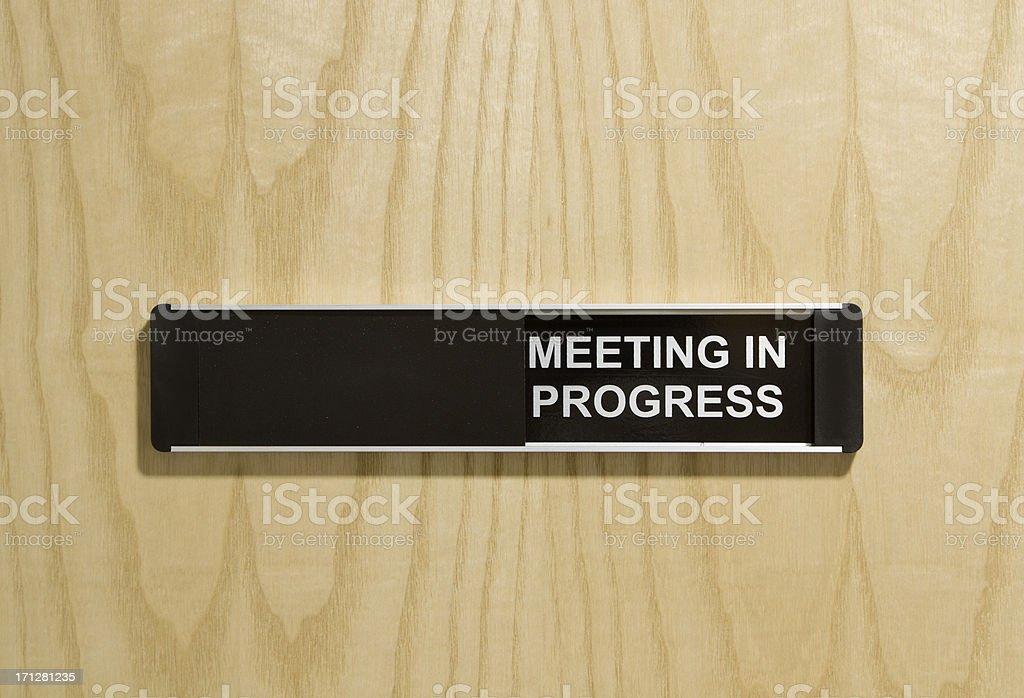 meeting in progress door sign