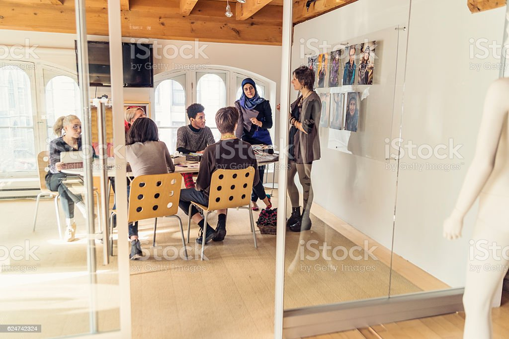 Meeting in small creative start-up enterprise lead by woman. stock photo