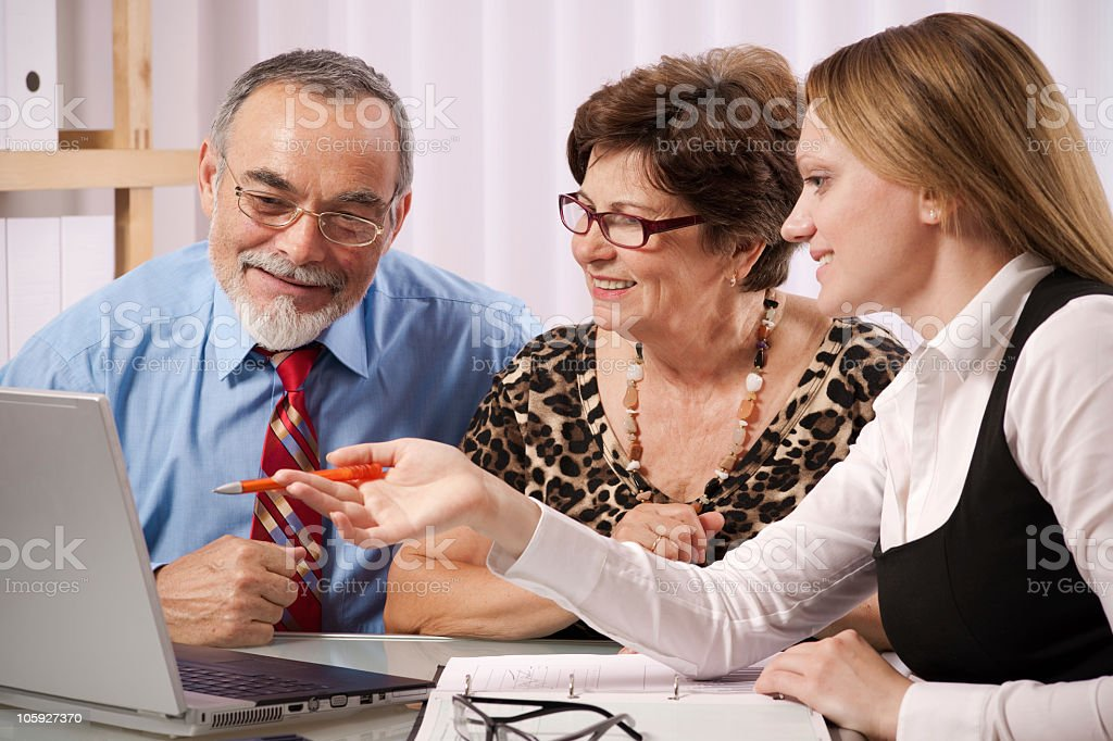 Meeting of a financial agent and clients royalty-free stock photo