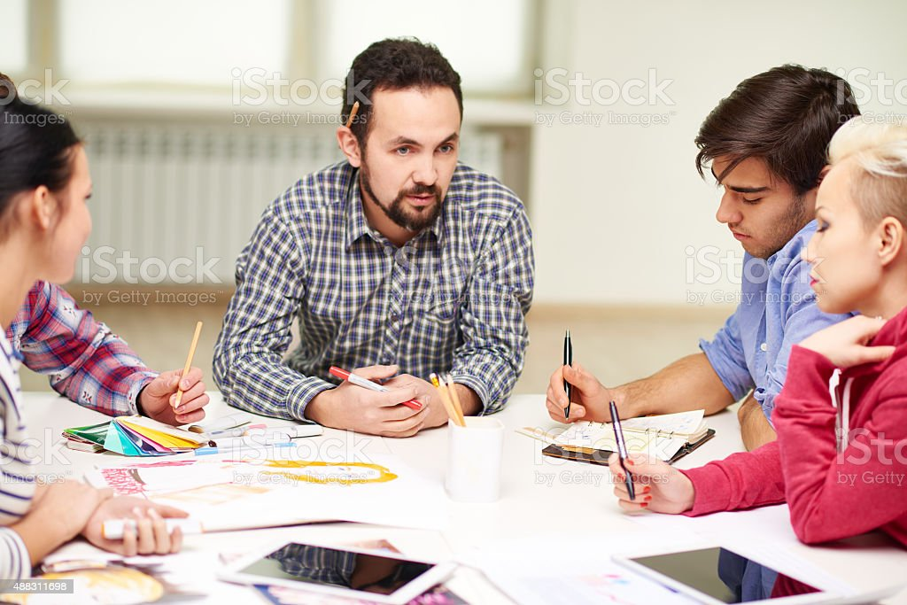 Meeting of designers stock photo