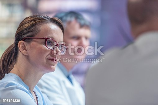 Medical doctor team at a meeting having conversation.