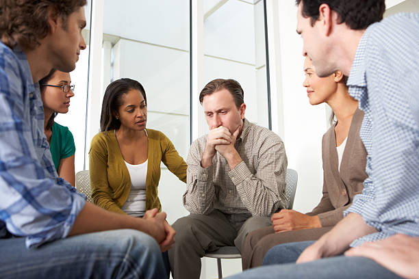 Meeting Of Support Group Meeting Of Support Group Having A Conversation group therapy stock pictures, royalty-free photos & images