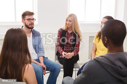 istock Meeting of support group, therapy session 859635806