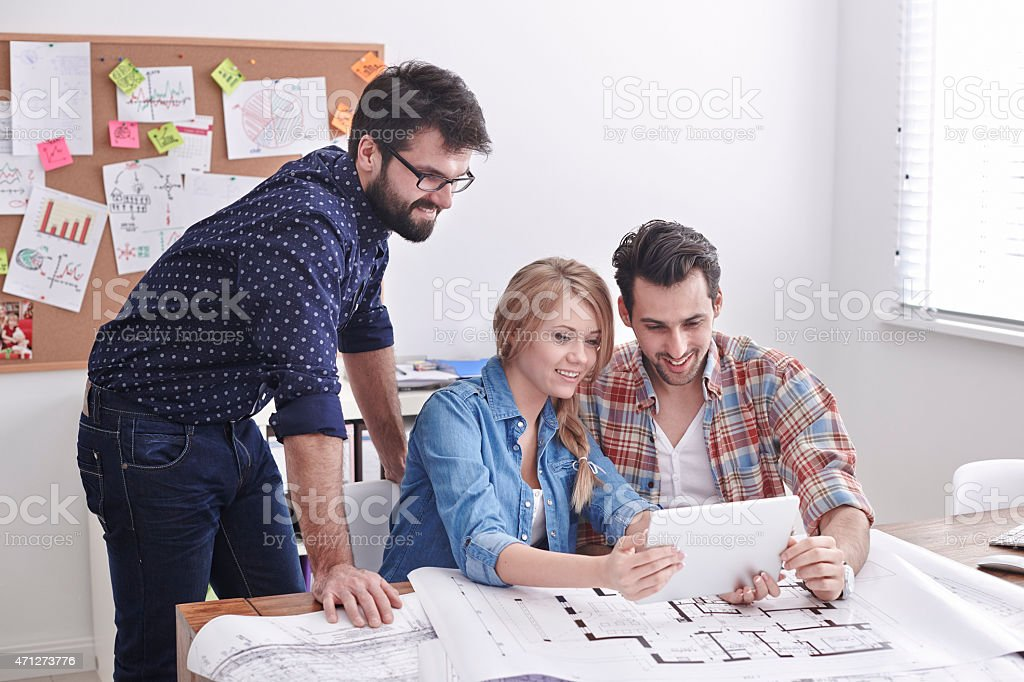 Meeting of young but creative architects stock photo