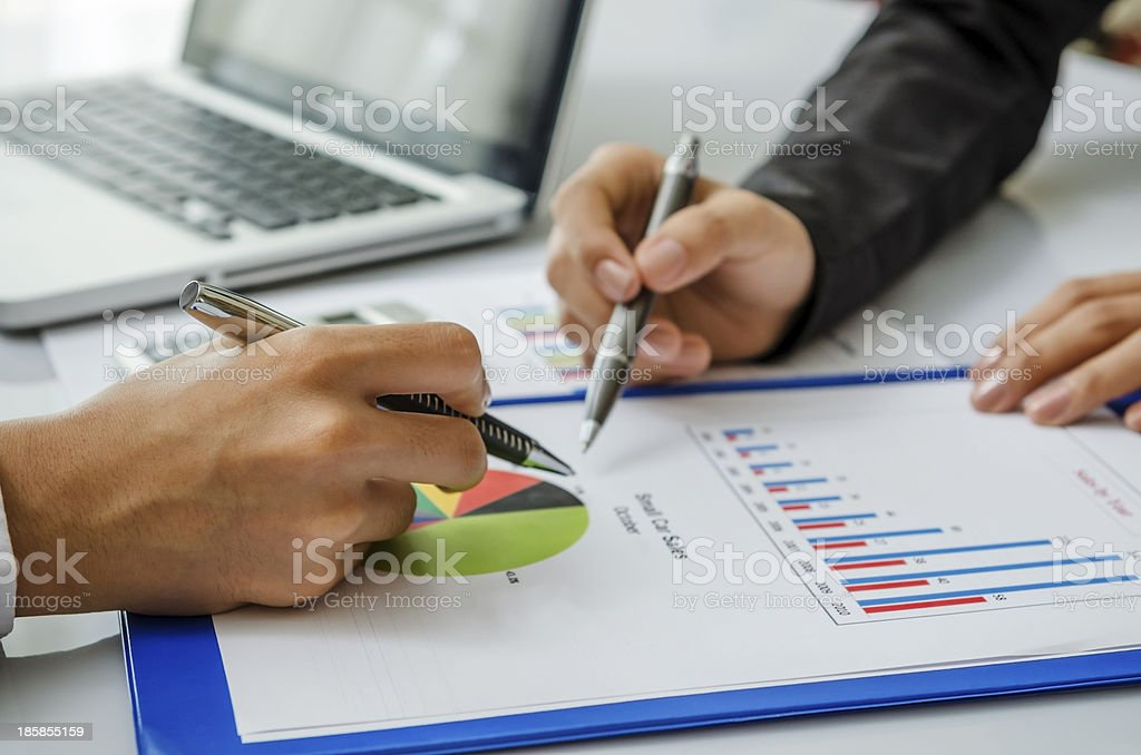Meeting on chart stock photo