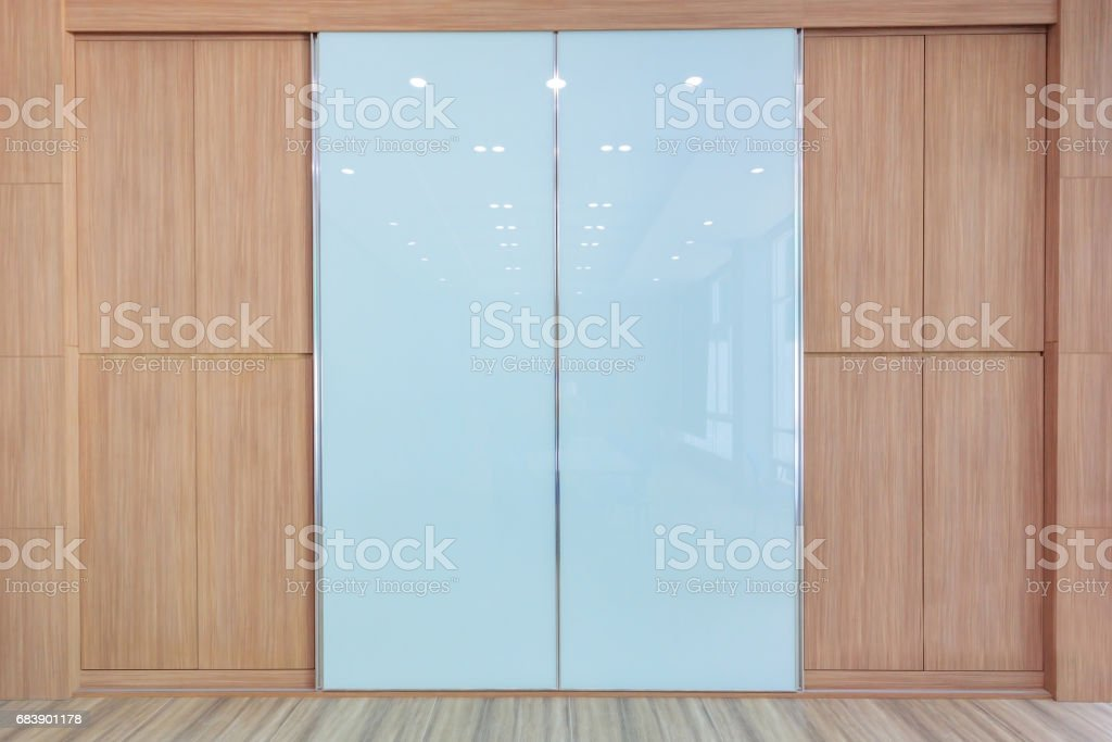 meeting room with empty room color wall and decorated with wooden floors royaltyfree