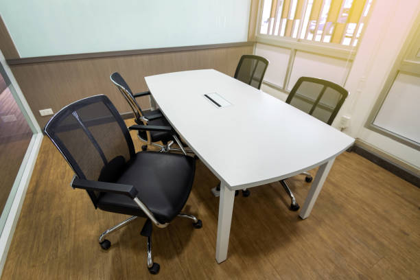 Meeting table and black chairs in meeting room stock photo