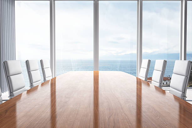 Meeting Table With Beautiful View Empty contemporary office meeting room interior design with beautiful view of the clouds and sea. empty desk stock pictures, royalty-free photos & images