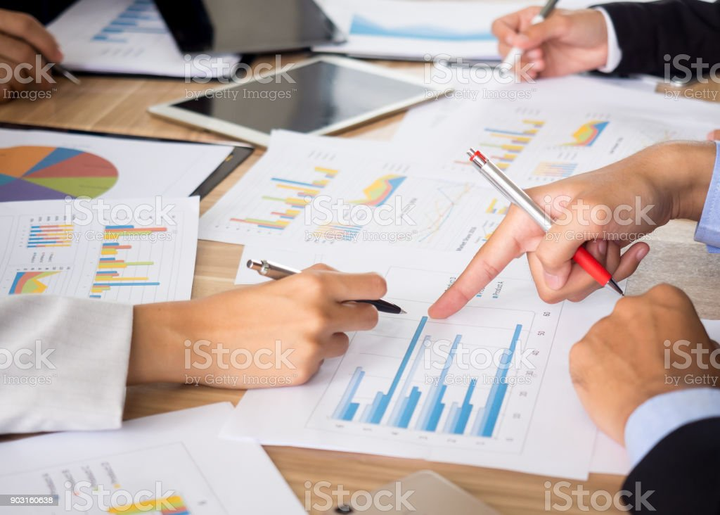 Meeting table/desk top view, businessman talking about business plan,...