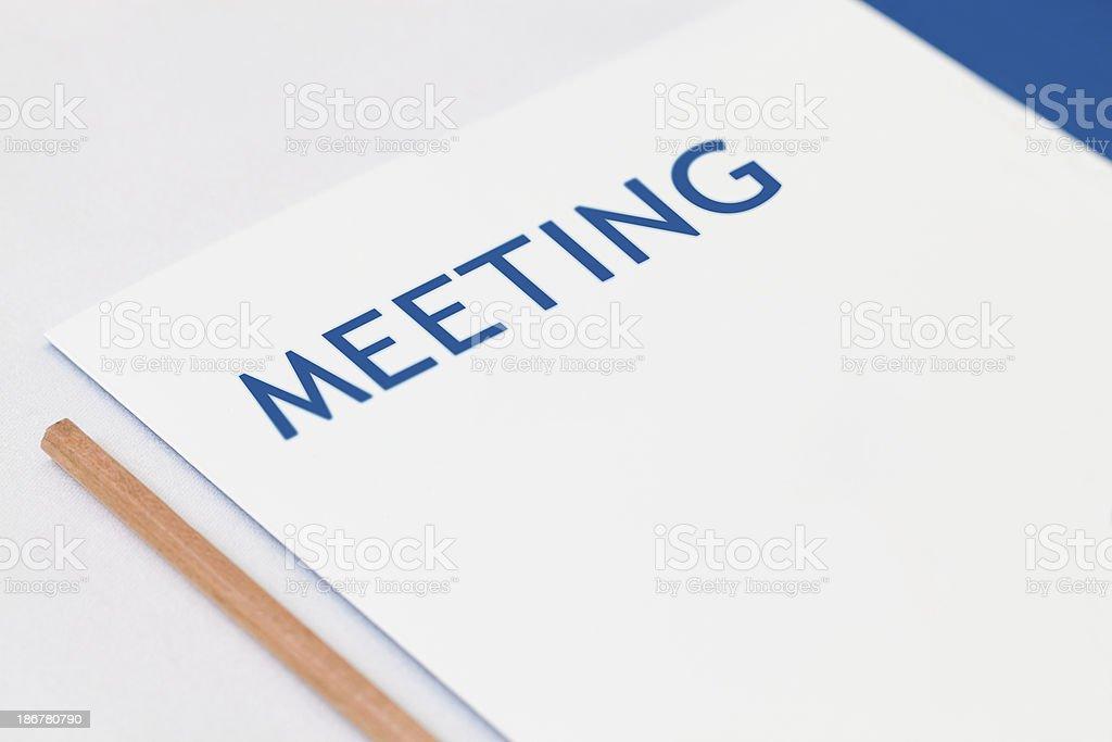 meeting text on folder royalty-free stock photo