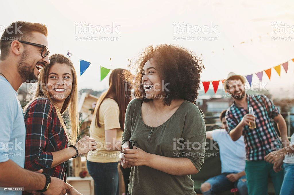 Meeting the friends on the rooftop stock photo
