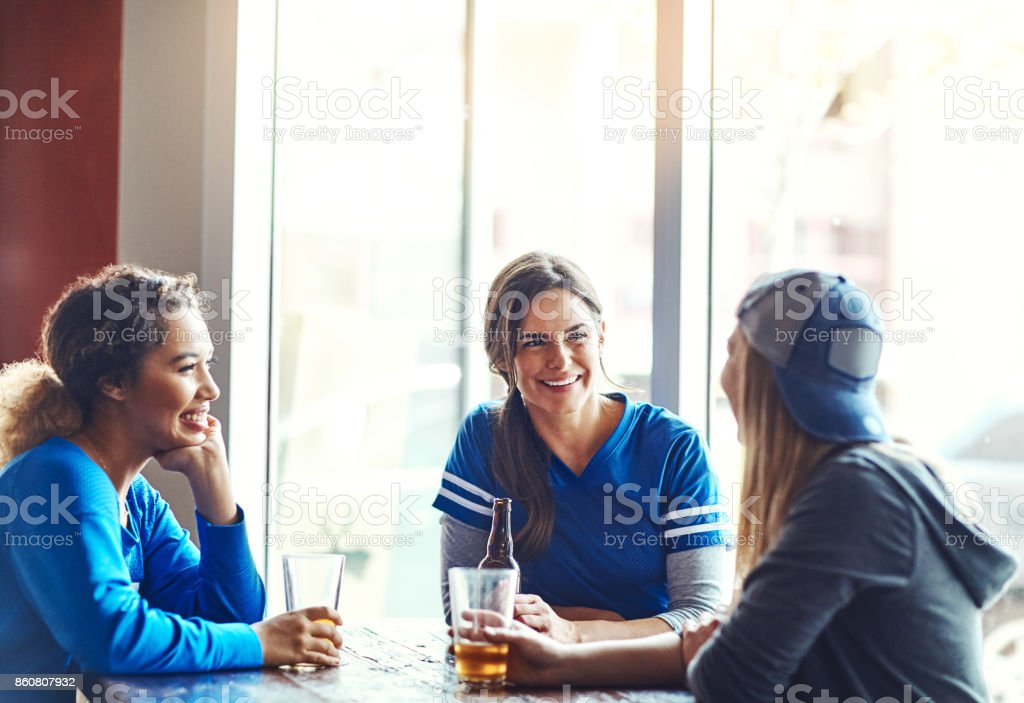 Meeting up at our favorite bar stock photo