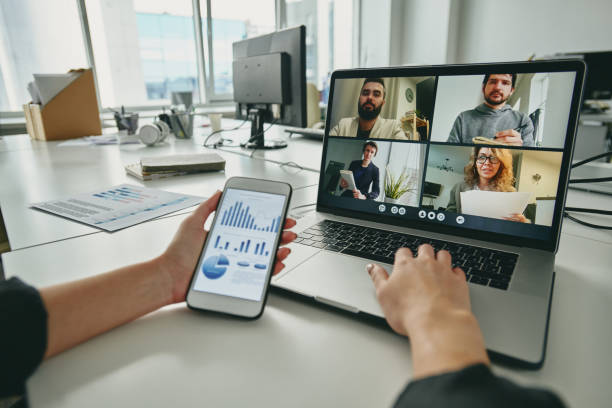 Meeting via video conferencing app stock photo