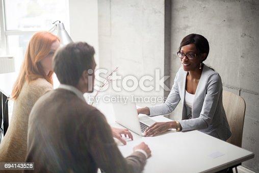 istock Meeting with financial advisor 694143528