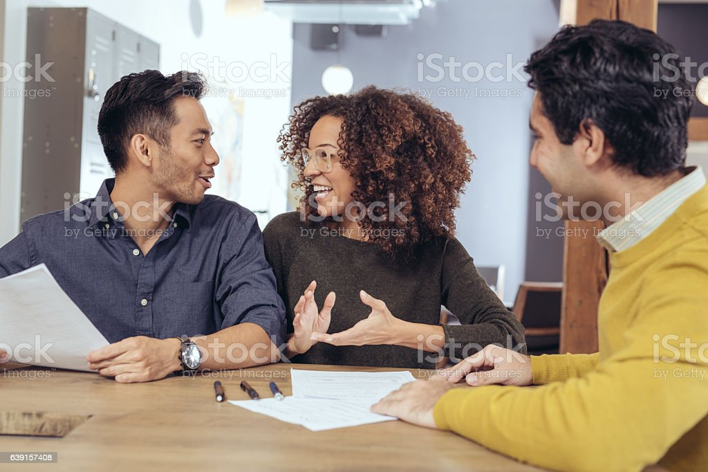 Meeting with home designer stock photo